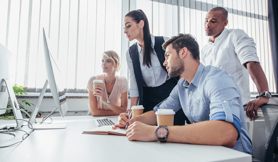 young multiethnic business people using desktop computer in office